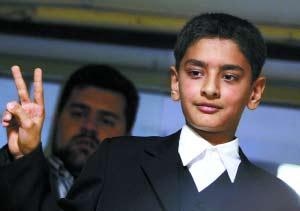 现任伊朗总统内贾德-中国评论新闻 12岁男孩成功报名参选伊朗总统